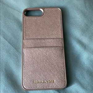 Michael Kors rose gold phone case.